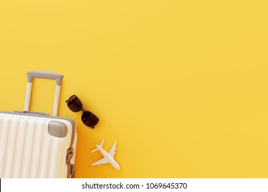 Flat lay white suitcase with sunglasses and plane on yellow background.travel concept