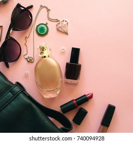 Flat lay of woman accessories and cosmetics on a pale pink pastel background. Place for your design, text, etc.