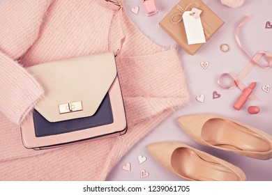 Flat lay of woman clothing and accessories in pastel colors. Modern classic style concept