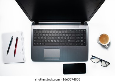 Flat lay of a work place. Top view of a laptop with accessories. Workspace on a background