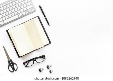 Flat lay workplace office desktop with keyboard and office supplies