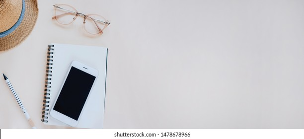 Flat lay of workspace desk with stationery and accessories in minimal style, copy space and banner style for text