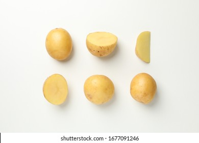 Flat lay with young potato on white background, top view