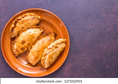 Flat lay.Homemade large empanadas with different stuffings.