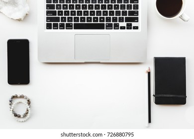 Flat Layout of Laptop Workspace on white Background with Black Items, Coffee, Phone, and Notebook with Room for Copy