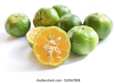 flat lemon called shikuwasa in white background