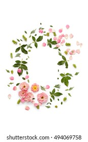 Flat nature floral round frame on white background, top view. Ornament with rose flowers, petals, succulent plants and green leaves.