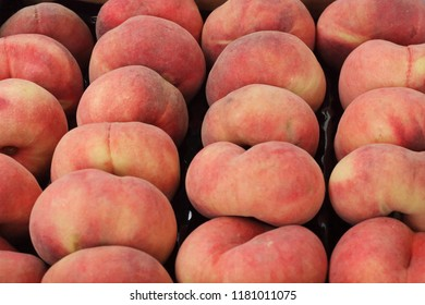 flat peaches in the market