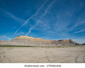 A flat plain in front of a table mountain like mountain range