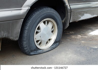 Flat rear tire on car