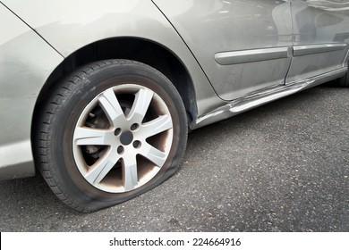 Flat rear tire on a car