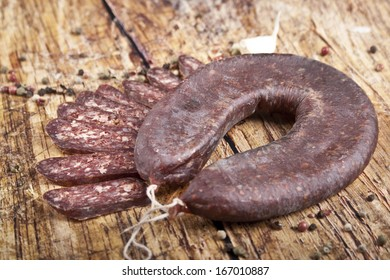 flat sausage over wood background