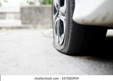 flat tire accident in car park on the street waiting for repair.flat tire and spare concept.copy space,