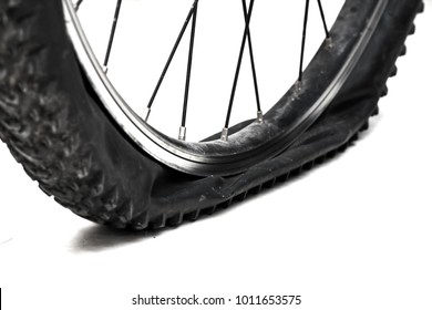 Flat tire bicycle isolated on white background