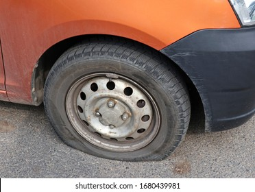 Flat tire of a car after an accident