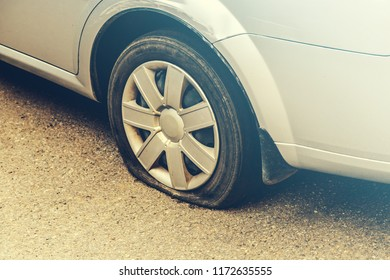 flat tire of a car close-up