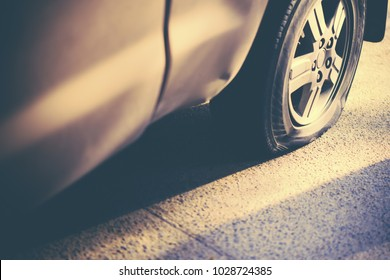 Flat tire with car , worn wheel vehicle Vintage Tone, transportation problem concept.