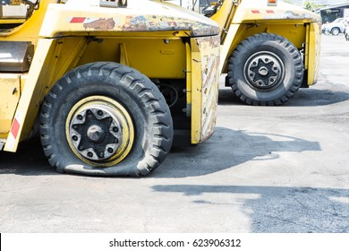 flat tire of heavy equipment container handler forklift