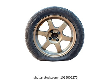 Flat tire isolated from white background.