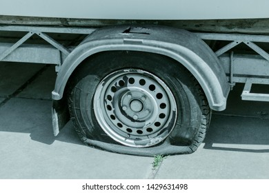 Flat tire. Punctured wheel. Trailer with a punched and flat tire