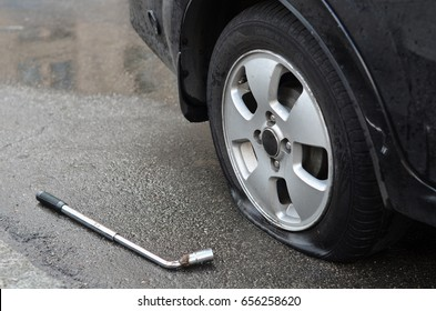 Flat tire and wrench