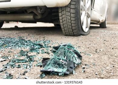 Flat wheels, broken car glass