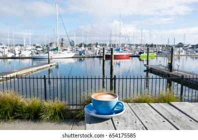 Flat white coffee in a blue cup at Marsden Cove Marina, Whangarei, New Zealand, NZ