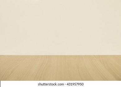 Flat wood floor and beige wall background.