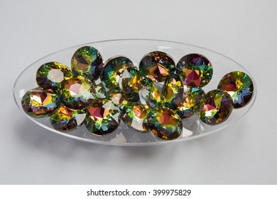 flatback multi-colored stones rhinestones lying in a clear plastic bowl
