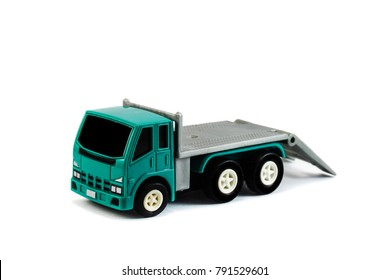 A flatbed towing truck toy on a white background. Towing gate down.