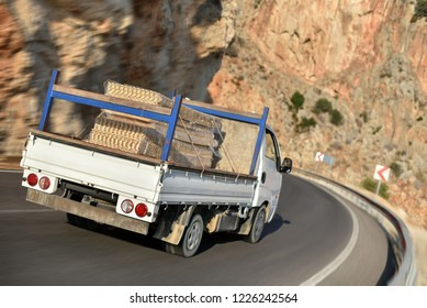 flatbed truck with cargo in mountains road