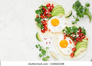 Flatbread with avocado, egg and mexican salsa. Top view with copy space for text. Healthy breakfast or lunch food