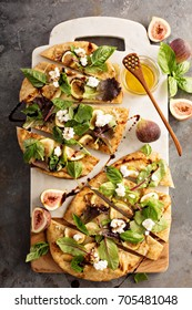 Flatbread fall pizza with balsamic, figs, cheese and salad leaves