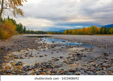 Flathead River, Montana early morning in autumn with colorful fall trees in background