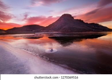 Flatiron Reservoir, Loveland, Colorado, Larimer County, lake, pond, water, frozen, ice, winter, season, seasonal, light, sun, Morning glow on the Flatiron reservoir butte on a winters morning