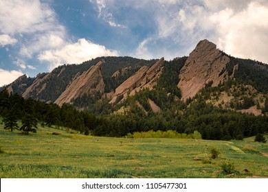 Flatirons of Boulder, Colorado with Chataqua Park in the foreground and nice cloudy skies