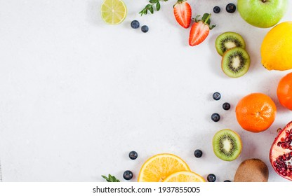 Flatlay assorted fresh and ripe fruits and berries. The concept of healthy eating. Copy space.