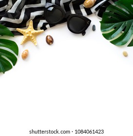 Flatlay beach accessories on white background. Top view travel or vacation concept. Summer background.
