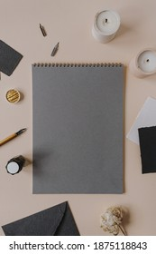 Flatlay blank paper sheet pad, fountain pen, ink on beige background. Minimalist home office desk workspace. Business, work, lettering, handwriting template. Flat lay, top view. Copy space mockup.