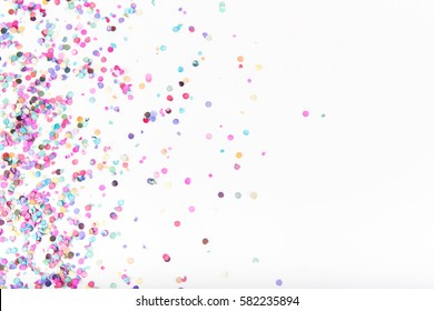 Flatlay of Colorful Round Paper Confetti on White Paper