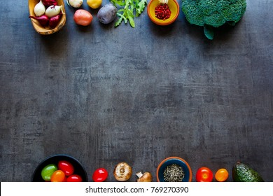 Flat-lay of fresh ingredients. Healthy cooking background with organic vegetables for vegan, gluten free, allergy-friendly, clean eating and raw diet. Vintage concrete background and top view