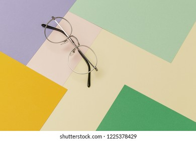 Flatlay image of glasses on the background of pastel colors.