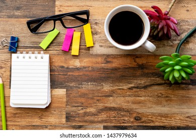 Flatlay on composition copy space of wooden table desk with working items