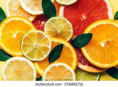 Flatlay pattern of citrus orange, lemon, lime and grapefruit slices background. Top view. Minimal design.