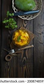 Flatlay photography idea- Mango on wooden board. Summer food