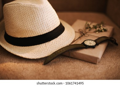 Flatlay of summer straw hat, retro hand watches and a book. Traveler items, vacation travel accessories, holiday weekend, day off, travelling stuff, equipment background, view concept