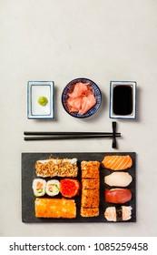 Flat-lay of sushi set on grey concrete background