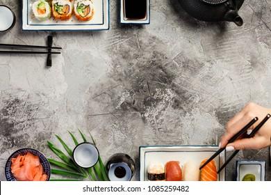 Flat-lay of sushi set on a grey stone background