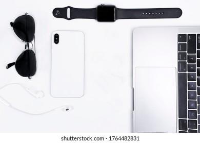 flat-lay top shot gadget modern phone notebook watch sunglasses pen notebook techonology