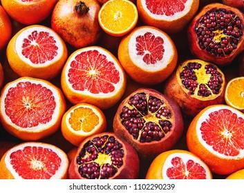 Flatlay view of orange, pomegranate, lemon, grapefruit